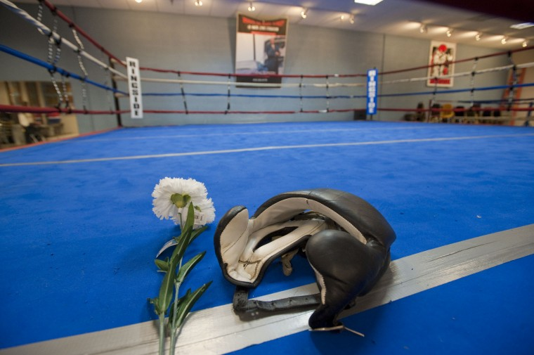 2010: Flowers rest next to head gear on the mat at Mack's Gym to honor boxing legend and trainer Mack Lewis, who passed away. (Karl Merton Ferron/Baltimore Sun)