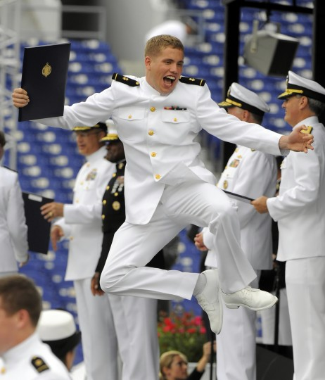 2010: Matthew Burchill of Detroit, MI, jumps in the air after receiving his diploma during the United States Naval Academy graduation and commissioning ceremonies for the class of 2010. (Lloyd Fox/Baltimore Sun)
