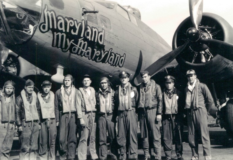 1943: The Fortress, which was late getting back from a raid yesterday after attacks by six enemy fighters, is shown here with her original crew. (Lee McCardell/Baltimore Sun)