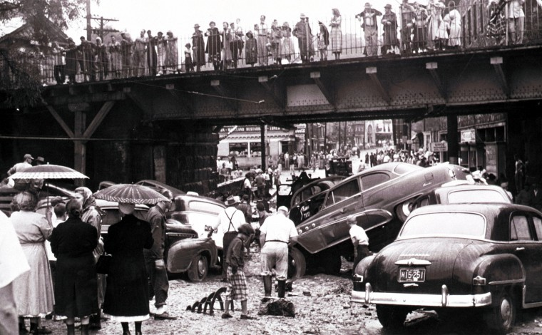 1952: Heavy rains brought by the hurricane produced a flash flood in Ellicott City, which washed 21 cars down main street along with household furnishings and store merchandise. Pictured are some of the cars piled up near the depot yard at Main Street and Maryland Avenue. (Frank A. Miller/Baltimore Sun)