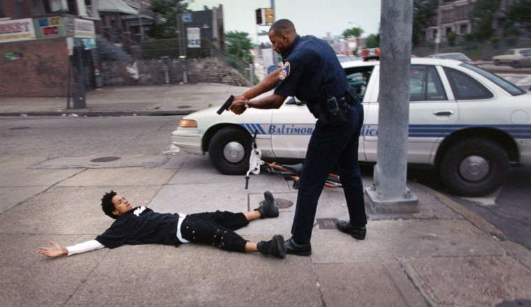1997: Ofc. Ray Cook detains a carjacking suspect at gunpoint after knocking him off his bicycle. The juvenile was wanted on an armed carjacking warrant and was identified on Edmondson Ave. He was taken down at the corner of Edmondson and Allendale. (André F. Chung/Baltimore Sun)