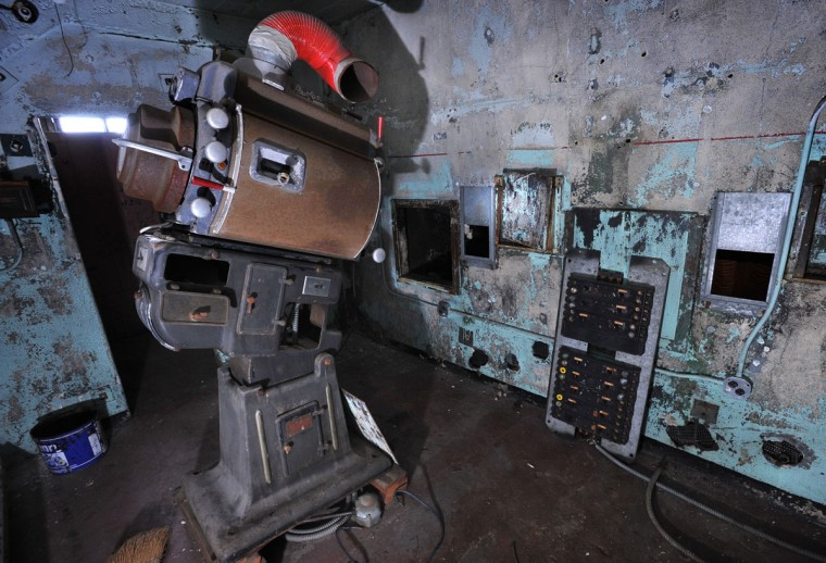 One projector housing remains in the cramped projection room of the Parkway. (Amy Davis, Sun Photographer)