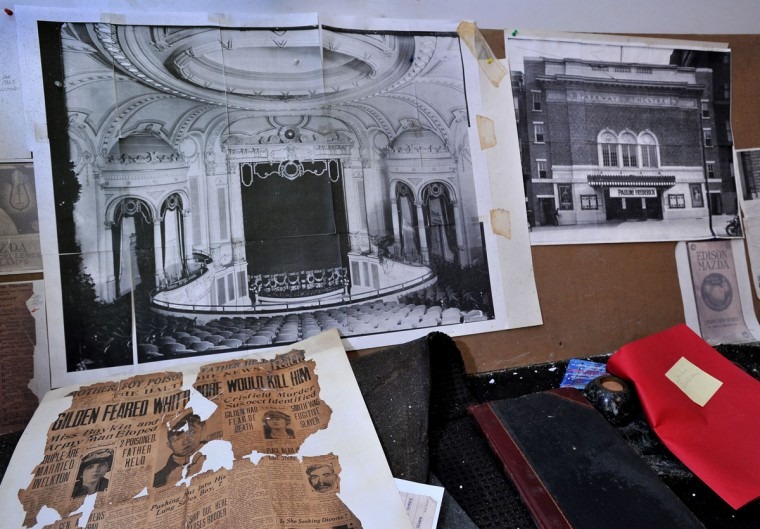 Old photographs taken shortly after the Parkway opened in 1915, on a decrepit display inside the theater. (Amy Davis, Sun Photographer)