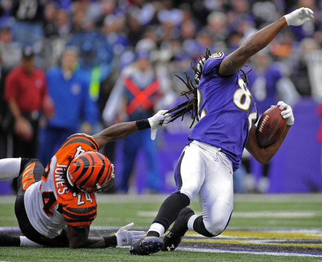 2011: Bengals cornerback Adam Jone, left, tackles Ravens wide receiver Torrey Smith by his hair. Smith gained 28 yards on the Joe Flacco pass. Baltimore Ravens beat the Cincinnati Bengals 31-24. (Christopher T. Assaf/Baltimore Sun)