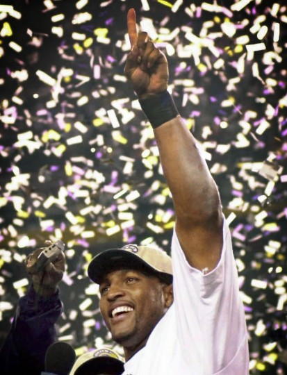 2001: Ray Lewis celebrates on the podium after being named MVP. (Gene Sweeny, Jr./Baltimore Sun)