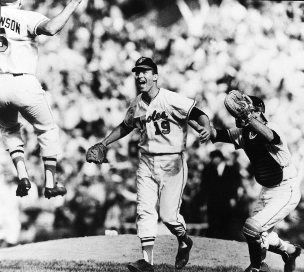 1966: Orioles pitcher Dave McNally (center) prepares to catch 3rd baseman Brooks Robinson, left, in his arms, as catcher Andy Etchebarren (right) follows McNally in celebration after the final out of the World Series game at Memorial Stadium. McNally shut out the Dodgers with a four-hit performance in the 1-0 game and Baltimore swept the series. (Paul Hutchins/Baltimore Sun)