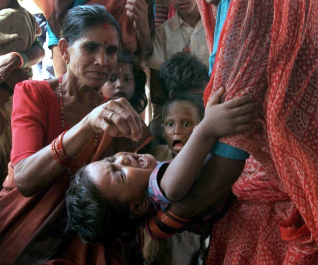 1999: Twice a year, Nepalis national vitamin A program gives a 2-cent dose of the vitamin to children 6 months to 3 years of age, whose all-rice diet leaves them malnourished. (Chiaki Kawajiri/Baltimore Sun)