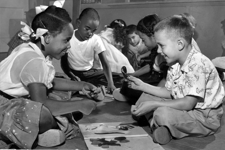 1955: Six-year-old Elizabeth Holly (left) and Gary Blum putting a puzzle together in the 1st grade at Public School 60. (Richard Stacks/Baltimore Sun)