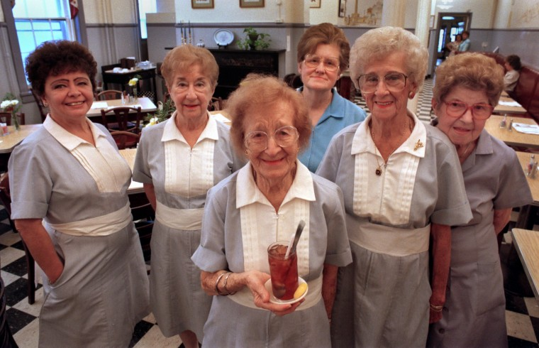 1995: The venerable waitresses at the Woman's Industrial Exchange, L to R: Trish Hall, 57, Loretta Tarbert, 80, Marguerite Schertle, 94 (holding ice tea), Charlotte Zimernack, 68, Carrie Geraghty, 88, and Margaret Brogna, 84. (Amy Davis/Baltimore Sun)
