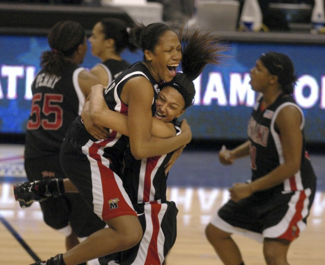2006: Laura Harper (top) hugs teammate Marissa Coleman after evening the score and securing overtime before winning the Championship. Teammate Jade Perry reacts at right. Maryland Terps defeat Duke 78-75 in overtime for the NCAA National Championship at TD Banknorth Garden in Boston, MA. (Elizabeth Malby/Baltimore Sun)
