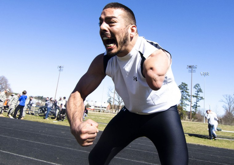 Ret. Sgt Michael Kacer, who lost his arm in an RPG attack in Afghanistan in 2009 celebrates a good run. (Noah Scialom, Independent Photographer)