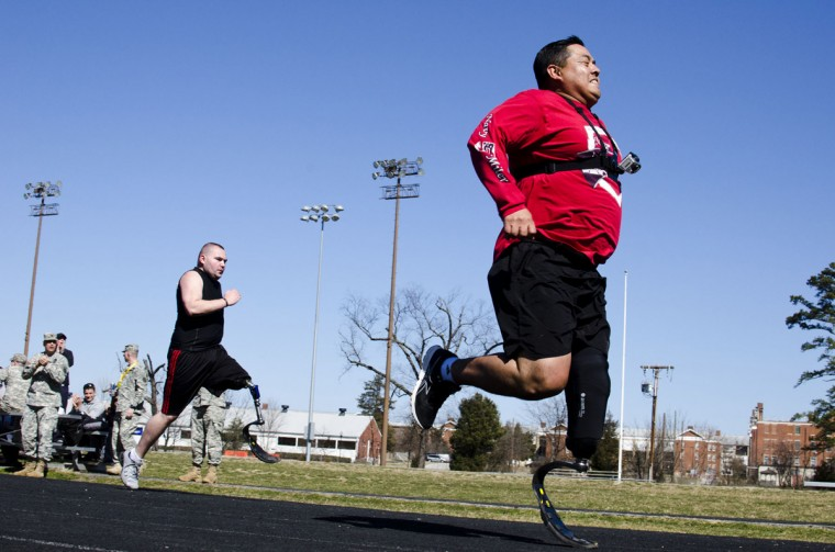 SSG Julio Larrea, right, and Chess Johnson, race each other around the track at Mullins Field (Noah Scialom, Independent Photographer)