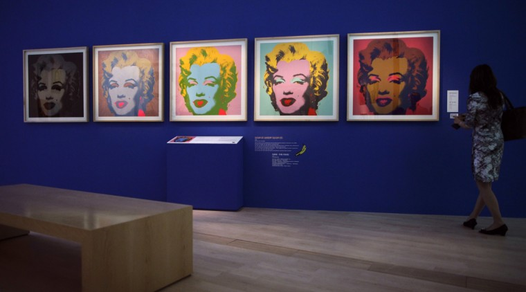 """A woman looks at Andy Warhol's """"Marilyn"""" during the media preview of the """"Andy Warhol 15 Minutes Eternal"""" exhibition opening on March 17, 2012 in Singapore. (REUTERS/Tim Chong)"""
