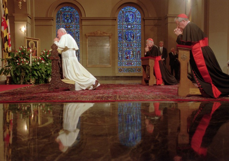 1995: Pope John Paul ll kneels and prays at the Basilica of the Assumption in Baltimore during a visit to the United States. (Chiaki Kawajiri/Baltimore Sun)