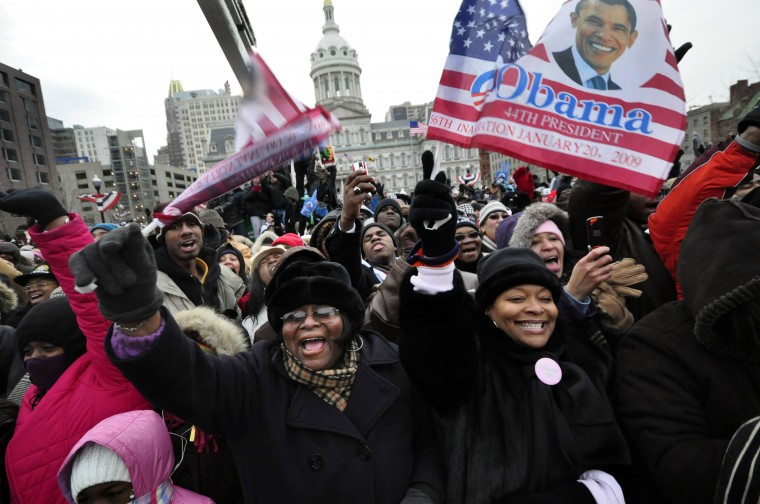 2009: Crowds cheer for President-elect Barack Obama as he makes a stop at Baltimore's War Memorial Plaza during his Inaugural Whistle Stop tour to Washington DC. (Karl Merton Ferron/Baltimore Sun)