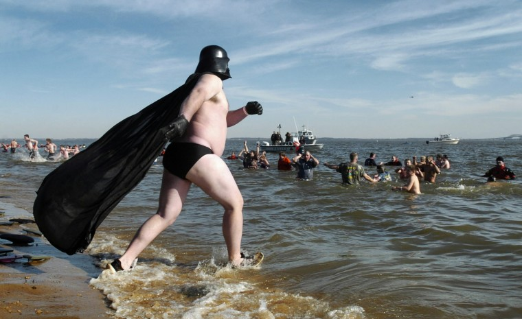 2006: Dressed as a scantily clad Darth Vader, Ed Griffin, of Reisterstown, runs into the Chesapeake Bay during his first ever Polar Bear Plunge. The air was 60 degrees, but the water was a less inviting 37 degrees for the tenth annual event. (David Hobby/Baltimore Sun)