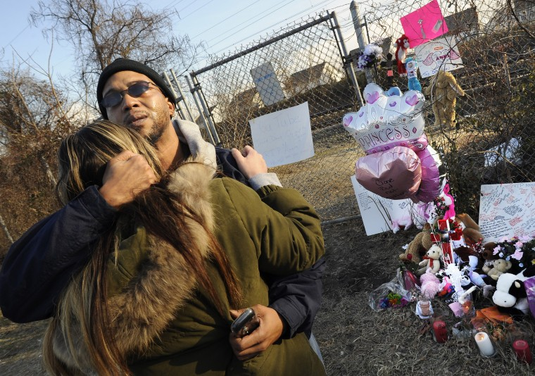 "2010: Darrell ""Tony"" Powell tries to comfort his girlfriend, Anna Haslup, aunt to Anna Marie Stickel, 14, who was struck and killed by an Amtrak train. (Jed Kirschbaum/Baltimore Sun)"