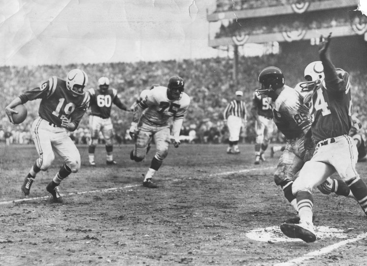 1959: Colts' #19 Johnny Unitas keeps the ball and races 4 yards to paydirt early in the 4th quarter. The touchdown put Colts ahead of the Giants 13-9. Helping out on the play is Colts' Lenny Moore (24) with a block on Giant linebacker Cliff Livingston (89). (Joe DiPaola, Jr./Baltimore Sun)