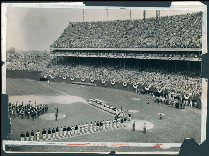 1954: Orioles Opening Day. Players stand for the National Anthem performed by the Army band. (Baltimore Sun) BUY THIS PHOTO
