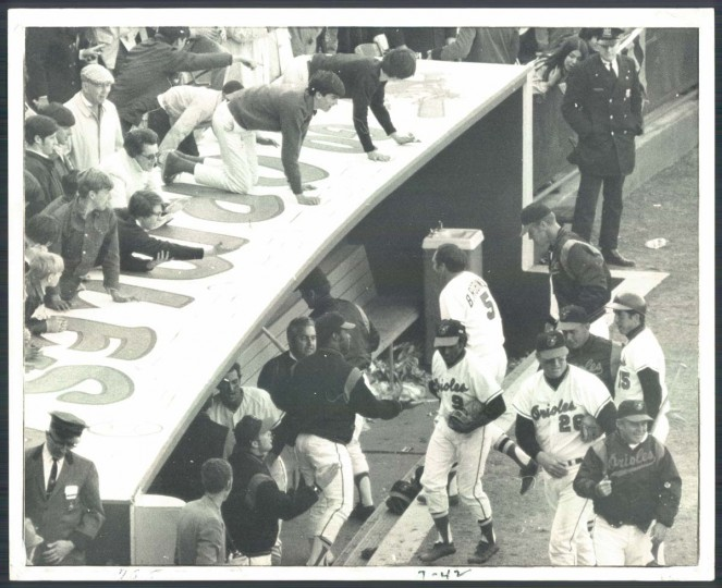 1970: Orioles Opening Day. Teammates and fans welcome hero Brooks Robinson as he heads for the dugout after a winning hit. (William Hotz/Baltimore Sun) BUY THIS PHOTO