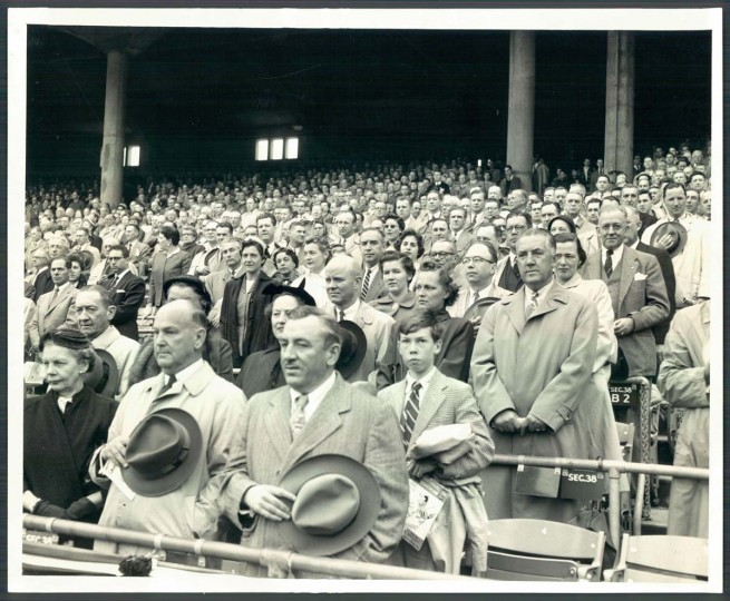 1965: Baseball fans stand during the National Anthem at the 1965 Opening Day. (Joe DiPaola/Baltimore Sun) BUY THIS PHOTO