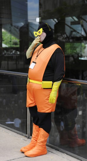 "In July 2009, Matthew Miklos of Stanford CT, whose character is called ""21,"" catches a smoke outside the Baltimore Convention Center, during the Otakon convention. (Barbara Haddock Taylor/Baltimore Sun)"