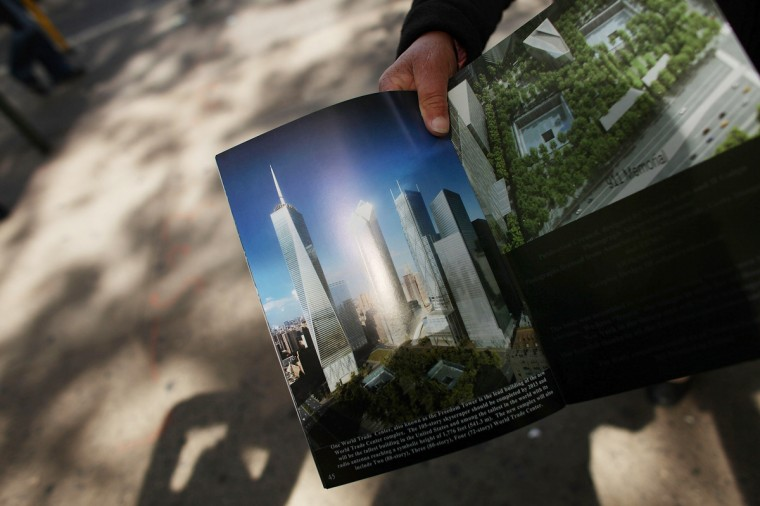 A street hawker holds a computer-generated image of the completed new One World Trade Center building, which is under construction on the site of the destroyed original World Trade Center. (Spencer Platt/Getty Images)