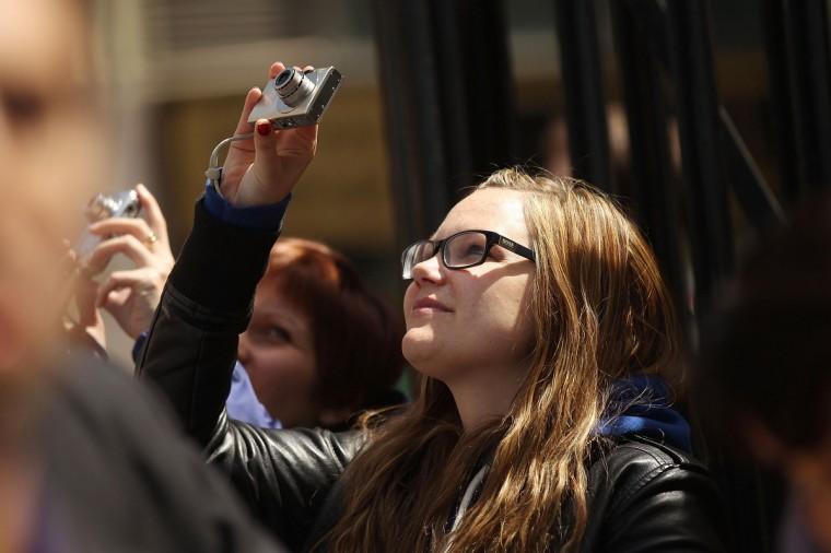 A woman takes a picture of the new One World Trade Center building. (Spencer Platt/Getty Images)