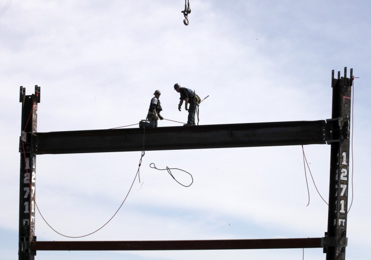 Ironworkers Jim Brady (L) and Billy Geoghan release a steel cable after connecting a steel beam between two columns at the top of One World Trade Center to make it New York City's tallest building. One World Trade Center is being built to replace the Twin Towers destroyed in the Sept. 11 attacks. It reached just over 1,250 feet on Monday. That's just taller than the observation deck on the Empire State Building. (Mark Lennihanl/Getty Images)