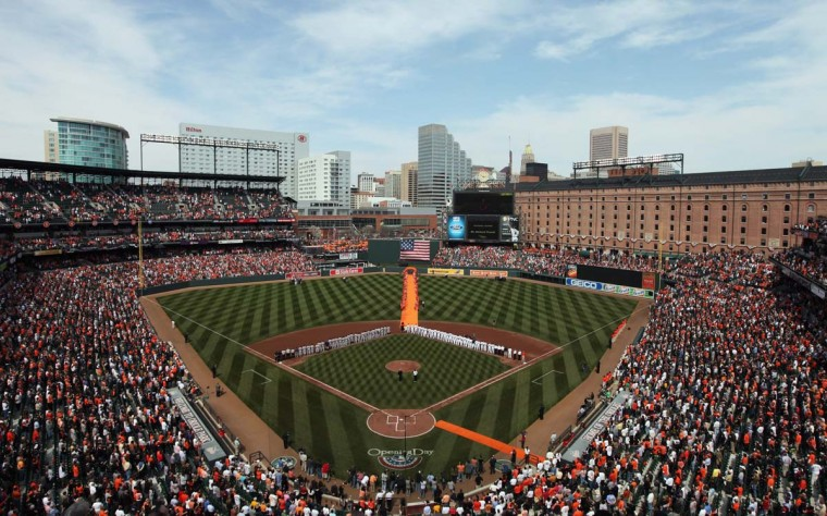 2011: The Detroit Tigers and Baltimore Orioles listen to the National Anthem during opening day at Camden Yards. (Rob Carr/Getty Images)
