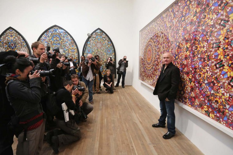 Artist Damien Hirst poses in front of his artwork entitled 'I am Become Death, Shatterer of Worlds' in the Tate Modern art gallery in London. The Tate Modern is displaying the first major exhibition of Damien Hirst's artworks, bringing together a collection over 70 of Hirst's works spanning three decades. The exhibition opens to the general public on April 4, 2012 and runs until September 9, 2012. (Oli Scarff/Getty Images)