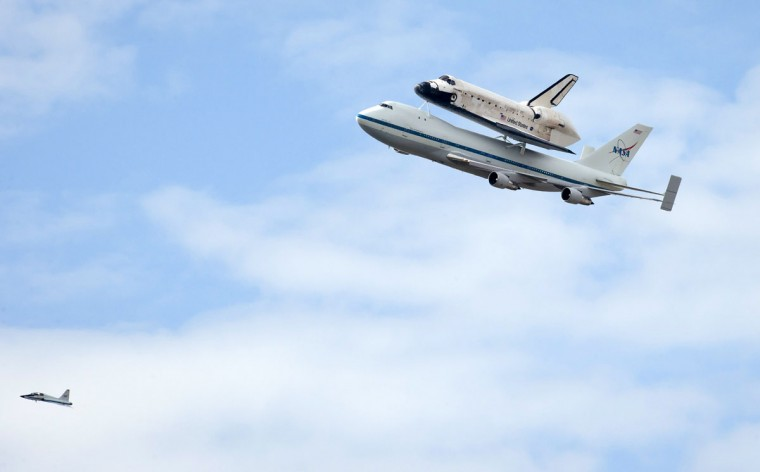 April 17, 2012: Space shuttle Discovery is tethered to the back of NASA 905 Shuttle Carrier Aircraft (SCA), a modified Boeing 747 jumbo jet, as it as it does a fly over of the U.S. Capitol in Washington, DC. (Rebecca Roth/NASA/Getty Images)