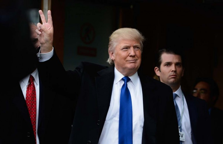 Donald Trump gives the victory salute to members of the public following his address to the Scottish Parliament in Edinburgh. (Jeff J Mitchell/Getty Images)