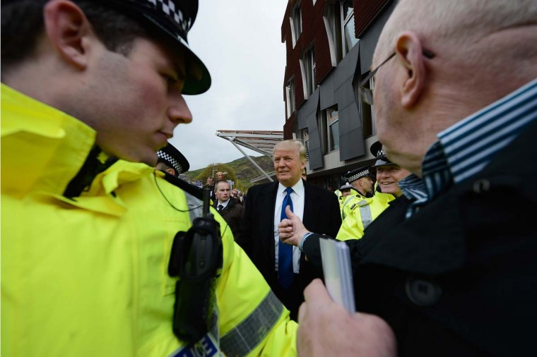 Donald Trump met with members of the Scottish Parliament on April 25 to discuss a wind farm being built near his new GBP 1 billion golf resort. (Jeff J Mitchell/Getty Images)