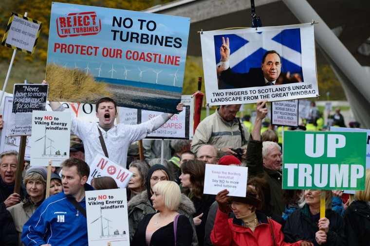 Anti-wind farm protestors demonstrate outside the Scottish Parliament as American tycoon Donald Trump pays a visit on April 25 to the Scottish Parliament. (Jeff J Mitchell/Getty Images)