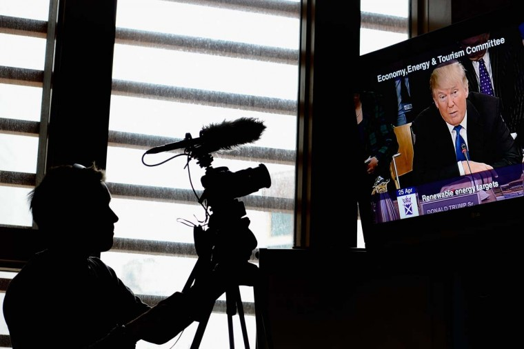 Media film Donald Trump's address to the Scottish Parliament. (Photo by Jeff J Mitchell/Getty Images)