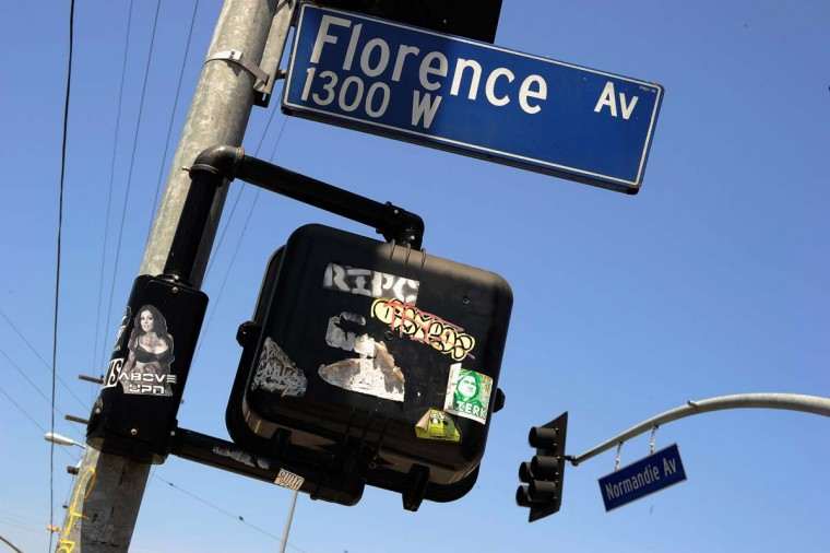 2012: A street sign marks the intersection of Florence and Normandy Avenues in South Los Angeles. The intersection was the scene of the beating of truck driver Reginald Denny on April 29, 1992 during the early stages of the Los Angeles riots. It's been 20 years since the Rodney King verdict that sparked the riots. (Kevork Djansezian/Getty Images)