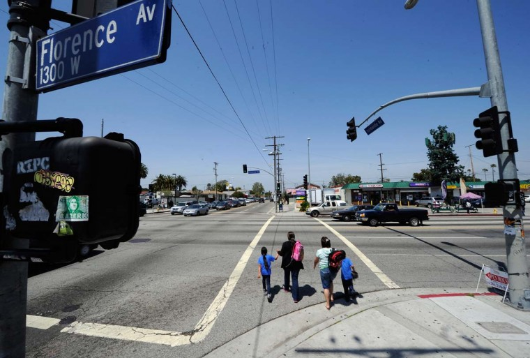 April 27, 2012: A family walks across the intersection of Florence and Normandy Avenues in South Los Angeles. (Kevork Djansezian/Getty Images)