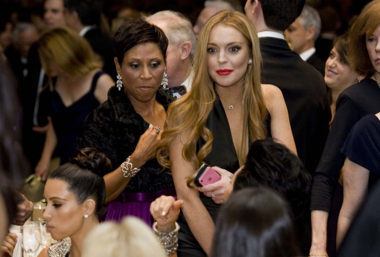Lindsay Lohan and her attorney Shawn Chapman Holley attend the 2012 White House Correspondents' Association Dinner held at the Washington Hilton on April 28, 2012 in Washington, DC. (Kristoffer Tripplaar-Pool/Getty Images)