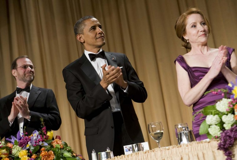 Steve Adler, U.S. President Barack Obama and Caren Bohan applaud at the 2012 White House Correspondents' Association Dinner held at the Washington Hilton on April 28, 2012 in Washington, DC. (Kristoffer Tripplaar-Pool/Getty Images)
