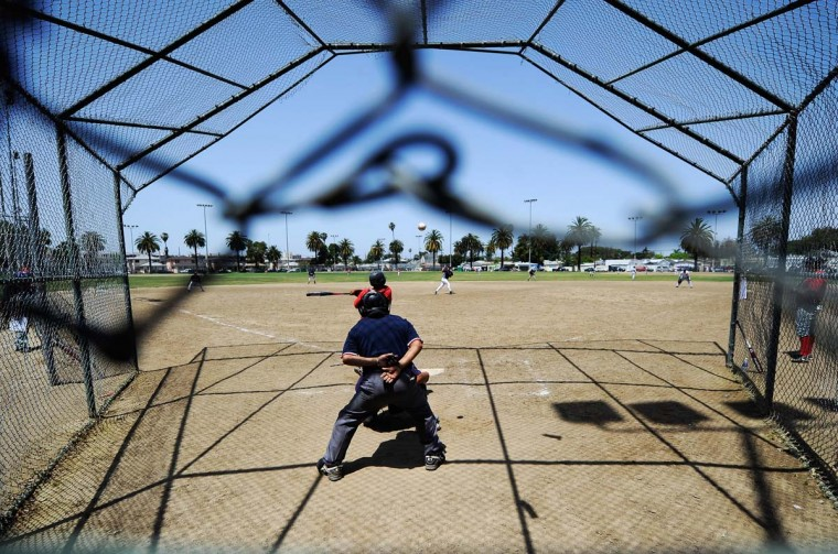 April 29, 2012: A group of baseball players play a game in the Jackie Tatum Harvard recreation center in South Los Angeles. (Kevork Djansezian/Getty Images)