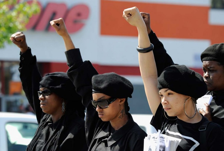 April 29, 2012: Members of the Black Riders, a new generation of the Black Panther Party, participate in a rally at the intersection of Florence and Normandie Avenues in South Los Angeles. (Kevork Djansezian/Getty Images)