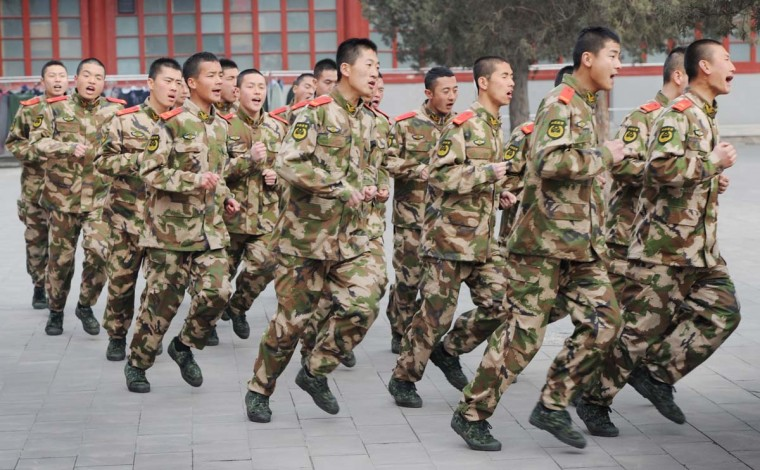 Chinese Paramilitary soldiers train outside their barracks in Beijing on March 19, 2012. Military spending in Asia will top that in Europe for the first time this year, the International Institute for Strategic Studies (IISS) said in its annual assessment of the strength of the world's armies. China leads the way in Asia and is engaged in a modernization program of its forces and military hardware financed by its rapid economic development. (Mark Ralston/AFP/Getty Images)