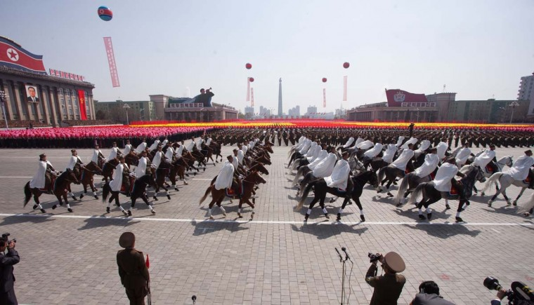 April 15: North Korean soldiers and horses are displayed during a military parade in honor of the 100th birthday of the late North Korean leader Kim Il-Sung in Pyongyang. (Ed Jones/AFP/Getty Images)