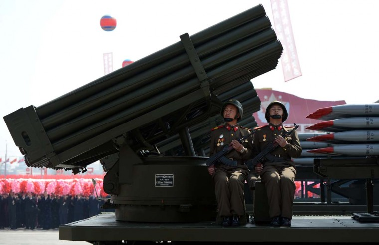 April 15: North Korean soldiers ride on the back of a multiple launch rocket system during a military parade to mark 100 years since the birth of North Korea's founder Kim Il-Sung in Pyongyang. (Pedro Ugarde/AFP/Getty Images)