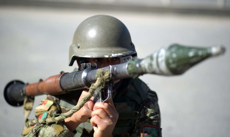 April 15: An Afghan Army soldier is armed with a rocket-propelled grenade during the attacks in the city of Kabul. Explosions and gunfire rocked the Afghan capital Kabul as suicide bombers struck across Afghanistan in coordinated attacks claimed by Taliban insurgents at the start of a spring offensive. (Johannes Eisele/AFP/Getty Images)