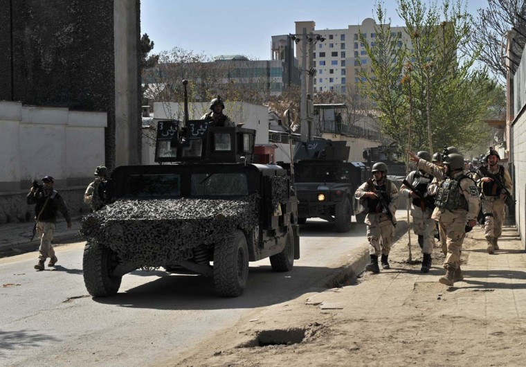 April 16: Afghan security forces arrive at the scene of an attack in Kabul. (Massoud Hossaini/AFP/Getty Images)