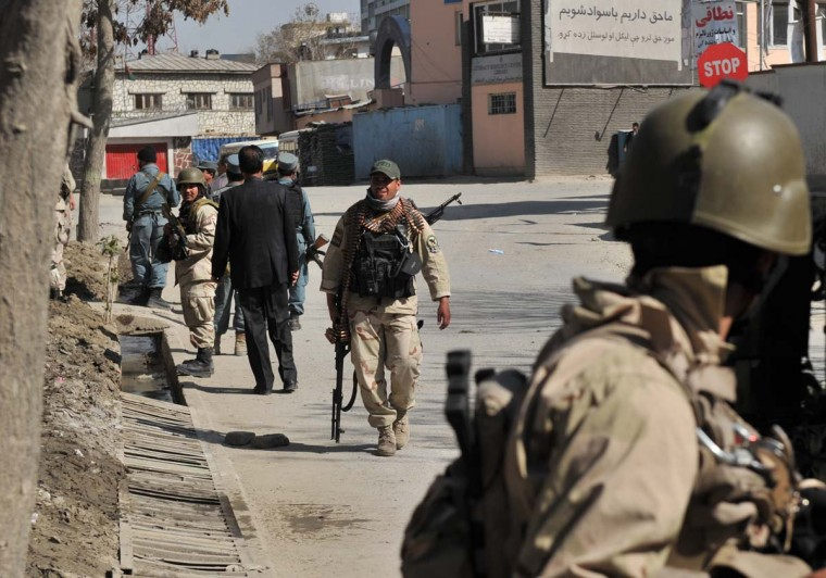 April 15: Members of Afghanistan's Ministry of Interior (MOI) walk near a building being used by insurgents near the scene of an attack in Kabul. (Massoud Hossaini/AFP/Getty Images)