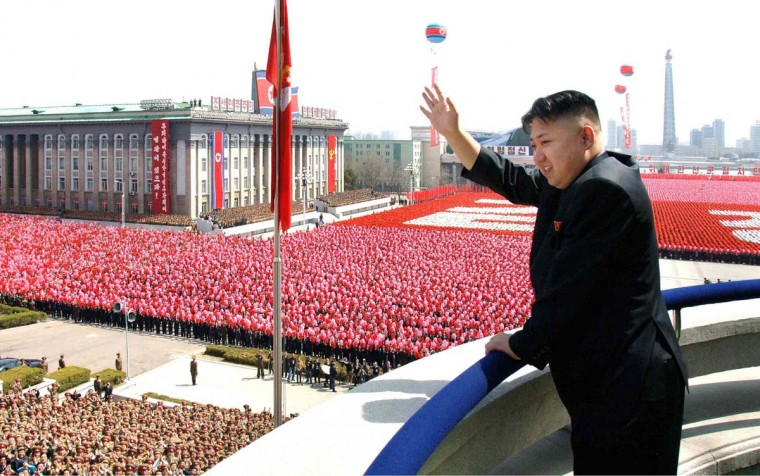 April 15: This picture, taken by North Korea's official Korean Central News Agency shows North Korean leader Kim Jong-Un waving as he reviews a military parade commemorating the 100th birth anniversary of former North Korean President Kim Il Sung at the Kim Il Sung Square in Pyongyang. (KNS/AFP/Getty Images)