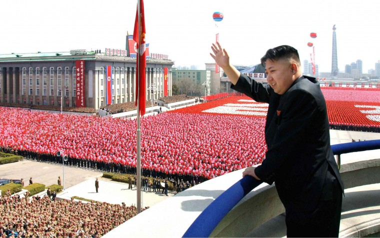 This picture, taken by North Korea's official Korean Central News Agency on April 15, 2012, shows North Korea leader Kim Jong-un waving as he reviews a military parade commemorating the 100th birth anniversary of former North Korean President Kim Il-sung in Pyongyang. Kim Jong-un delivered his first public speech and vowed to push for a stronger military. (KNS/AFP/Getty Images)